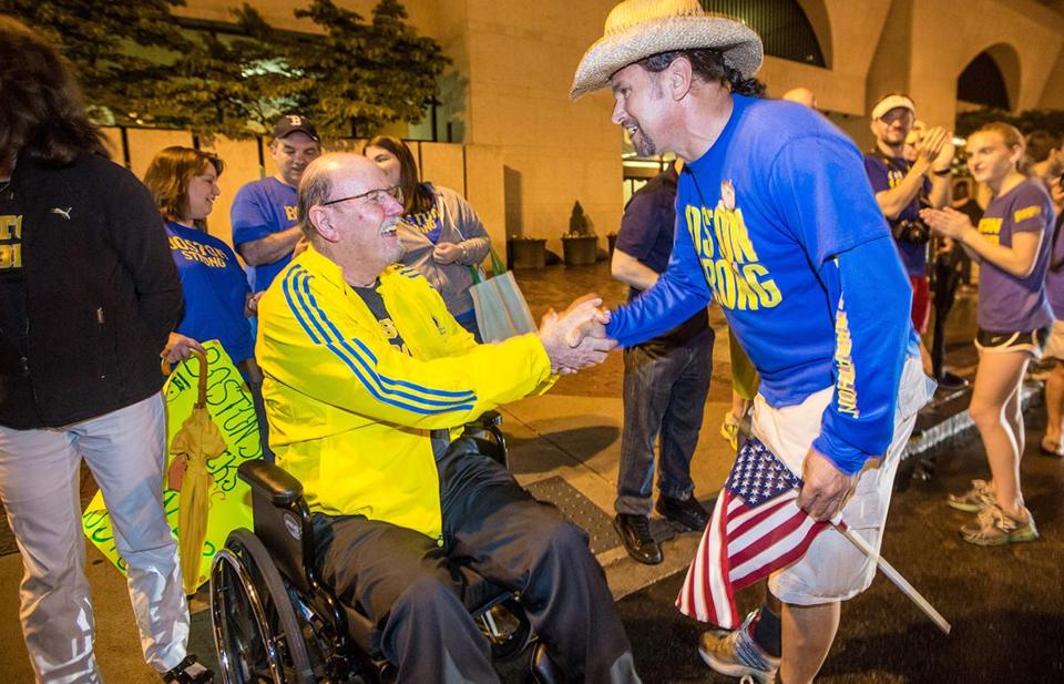 Carlos Arredondo shook hands with bombing victim John Odom at the One Run for Boston event on June 30, 2013.