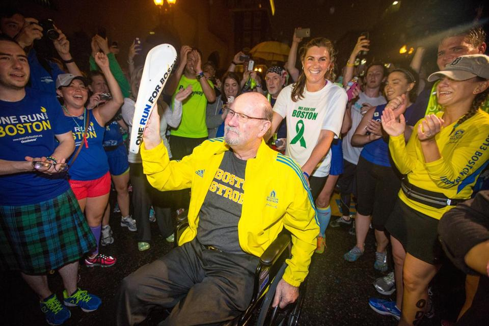 Marathon bombing victim John Odom was escorted across the finish line of One Run for Boston by his daughter Nicole Reis.