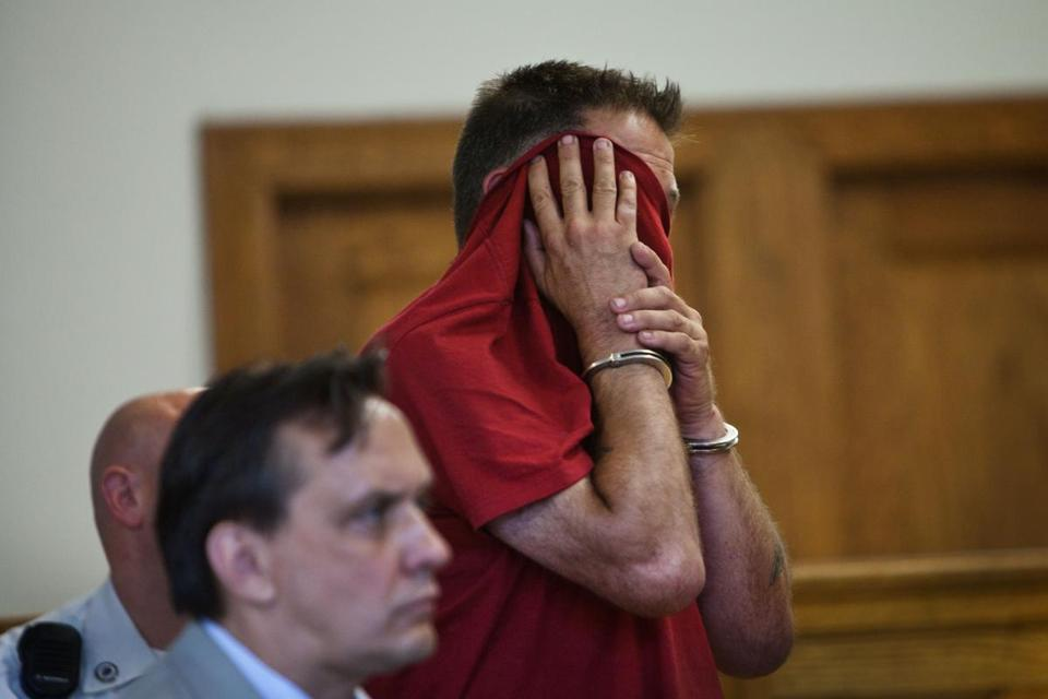Joseph Barthel, 49, covered his face during his arraignment in Charlestown Municipal Court.