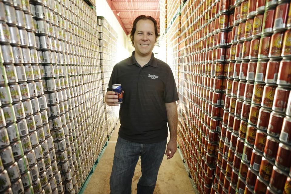 Brewmaster Brian O'Reilly holds a can of Helles Golden Lager with a 360 Lid as he poses for a portrait at Sly Fox Brewing Co. in Pottstown, Pa.