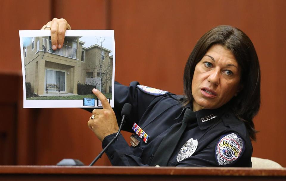 Police officer Doris Singleton on Monday displayed a copy of a photo of the complex where the shooting took place.