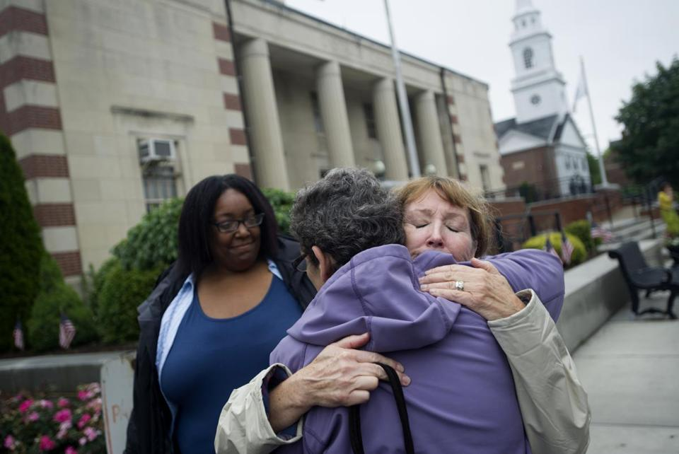 Mike's girlfriend, Renee Johnson (left), aunt Rhonda Bourne, and mom Peggy Bourne outside Dedham District Court.