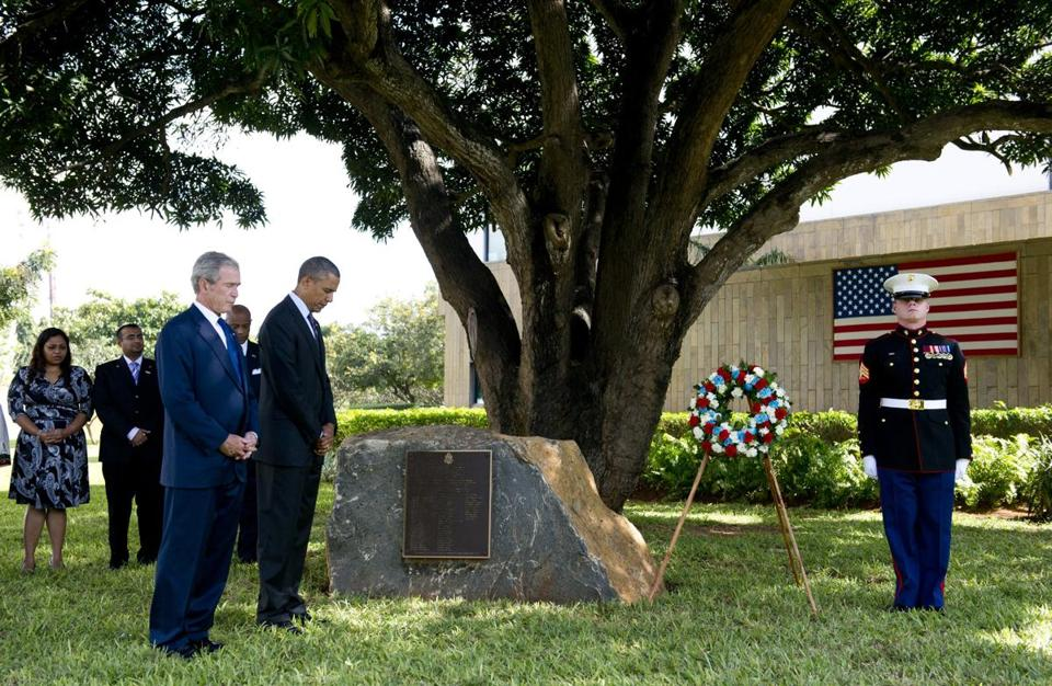 President Obama joined his predecessor, George W. Bush, at a ceremony marking the 1998 embassy attack in Tanzania.