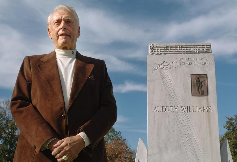 Charles Carr in 2007 at the Williams family graves in Montgomery, Ala. Below, an undated  publicity photo of Hank Williams. Mr. Carr directed the Hank Williams Museum.