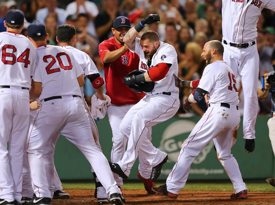 Jonny Gomes made like a fullback as he barrelled through a bunch of teammates after his dramatic home run.