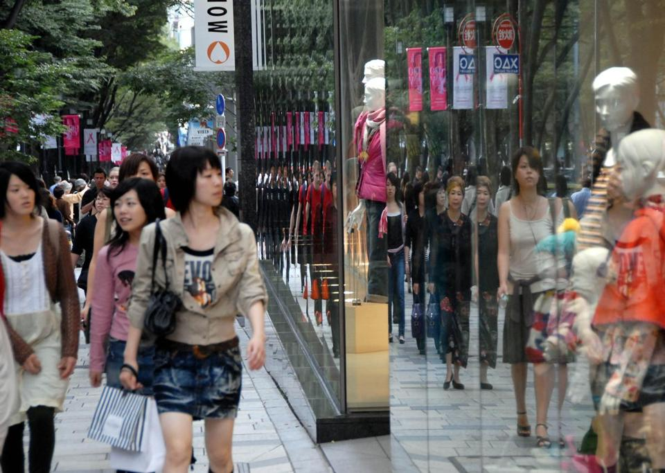 Shoppers walked along Tokyo's ritzy Omotesando Hills shopping mall.