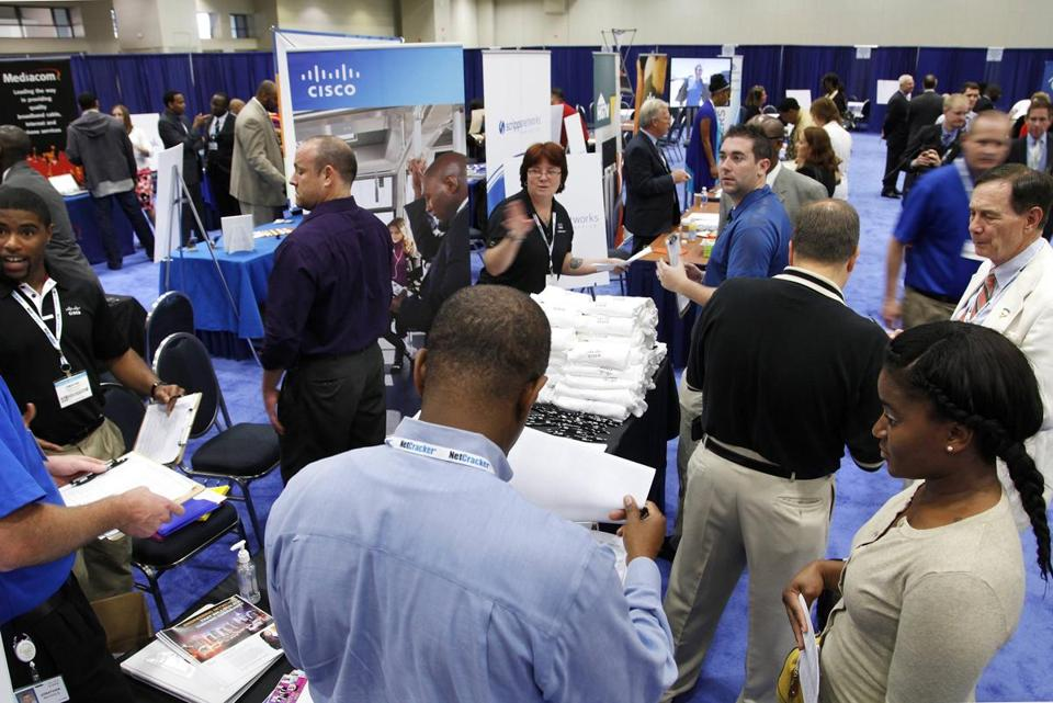 Job-seekers talked with recruiters at a job fair in Washington in June.