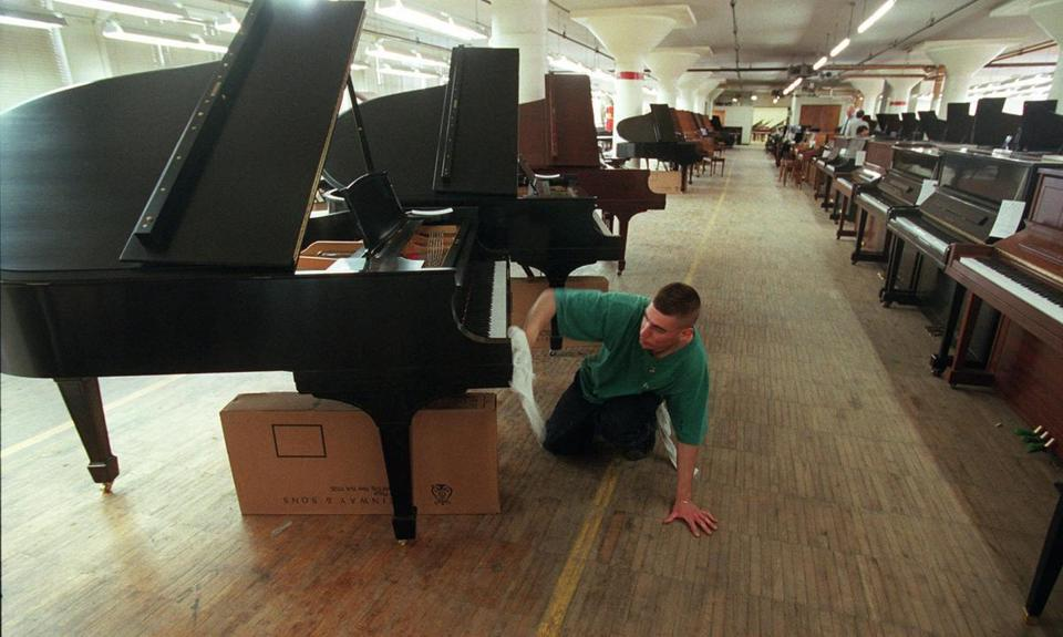 A typical Steinway grand piano costs about $50,000.