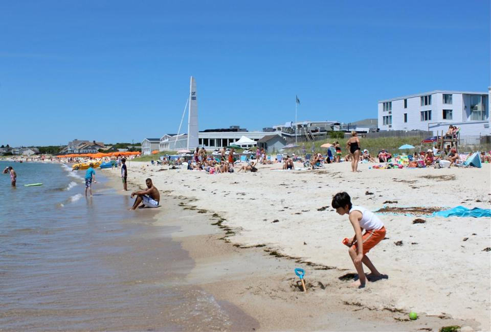 Visitors flock to North Falmouth's Old Silver Beach.