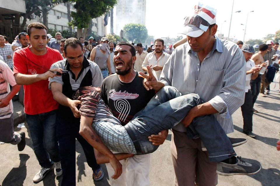 Supporters of ousted President Mohammed Morsi carried a wounded man in Cairo.