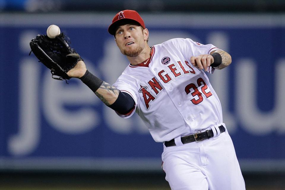 Josh Hamilton misplays a fly ball in the seventh Friday, leading to a Red Sox run.