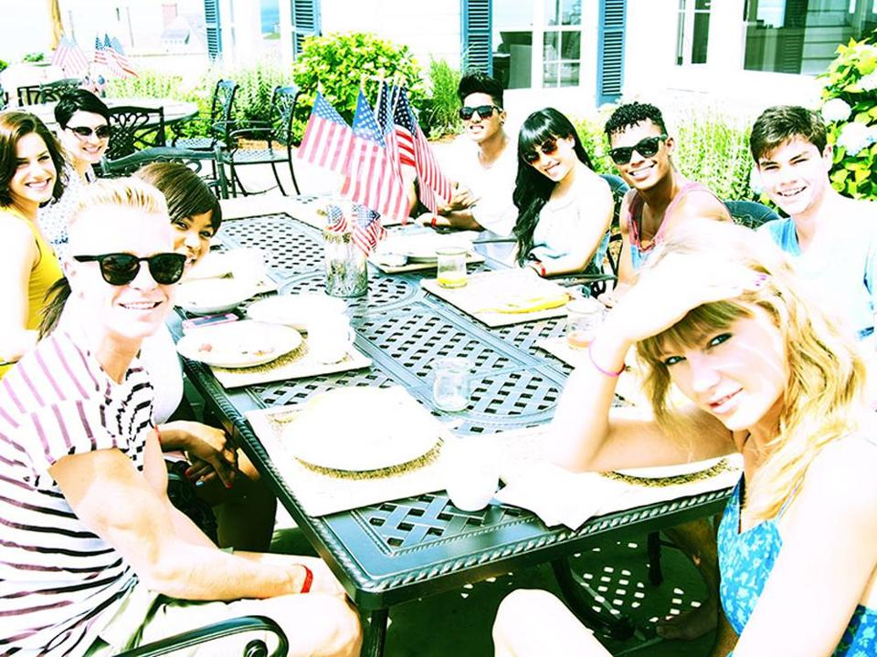 "Taylor Swift (front) and her ""touring family'' at the singer's Independence Day party at her beach house in Westerly, R.I."