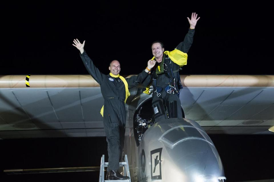 Pilots Bertrand Piccard (left) and Andre Borschberg, also chairman and CEO, respectively, of Solar Impulse, after their experimental solar-powered airplane landed in New York last July to complete a transcontinental flight.