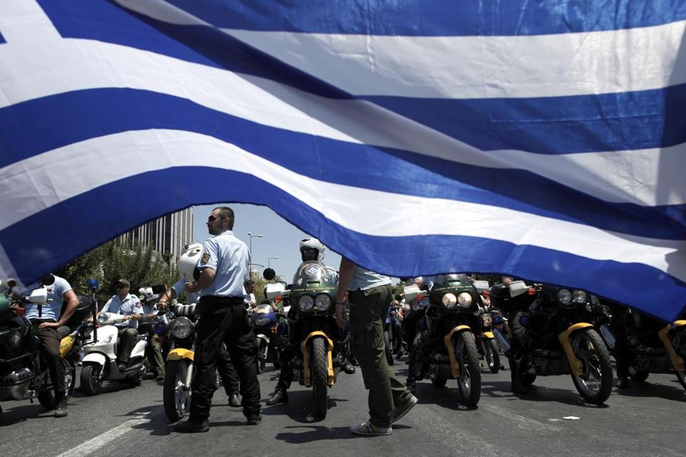 In Athens on Monday, municipal police protested Greece's plan to slash the number of civil servants in an austerity drive.