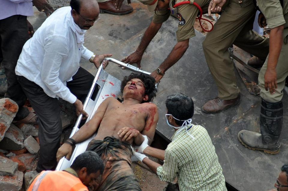 Rescue workers worked through the day to free victims trapped in the rubble of the hotel City Light, which collapsed in Hyderabad, India, early Monday, killing at least 12 people.