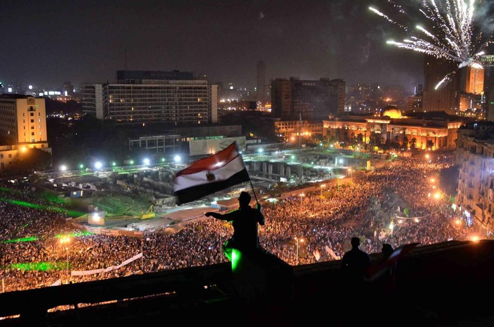 Egyptians waved the national flag as hundreds of thousands flooded Tahrir Square to protest the ouster of Islamist President Mohammed Morsi.