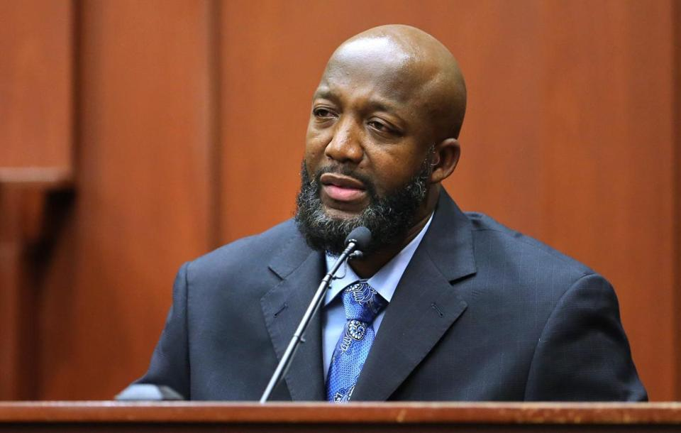 Trayvon Martin's father, Tracy Martin, says he never denied it was his son's voice on a 911 recording.