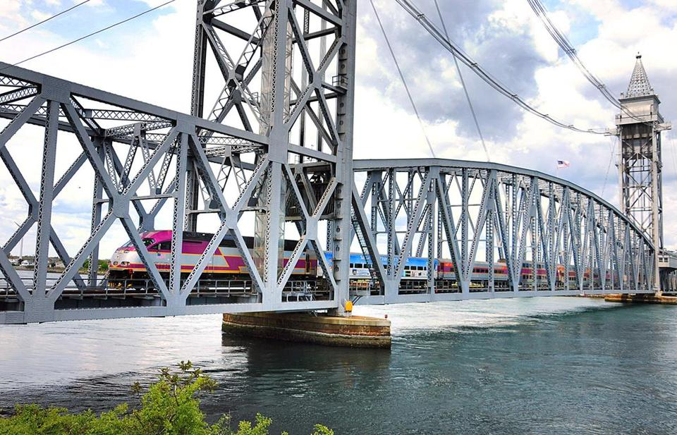 The CapeFlyer crosses the Cape Cod Canal on the vertical-lift Buzzards Bay Railroad Bridge.