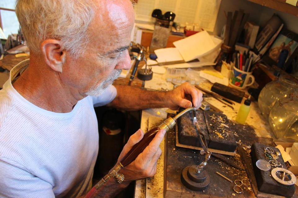 Ross Coppelman at work in his goldsmith's shop in Dennis.