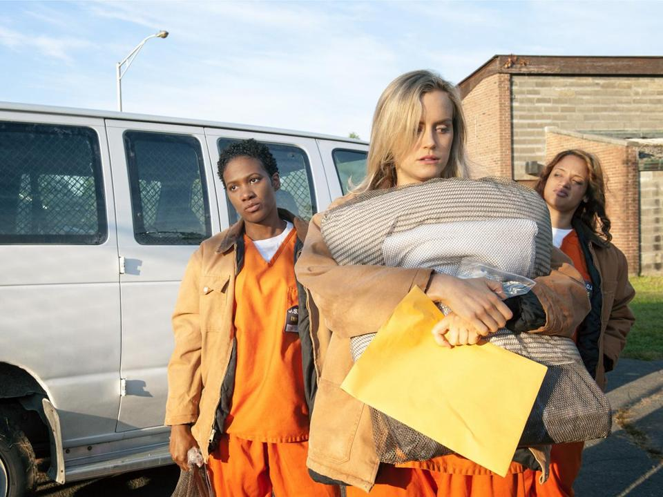 "Taylor Schilling (front) with Vicky Jeudy (left) and Dascha Polanco in the Netflix series ""Orange Is the New Black."""