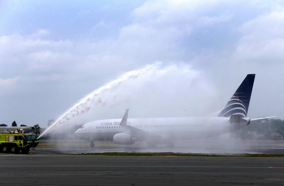 The inaugural Copa Airlines Flight 718 from Panama City was welcomed to Logan Airport with a traditional water canon salute.