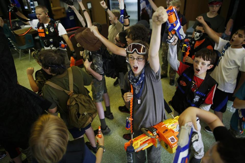 Benjamin Tull, 13, of Concord (center) cheers before taking on zombies during the climactic battle at Nerf Zombie Camp in Reading.