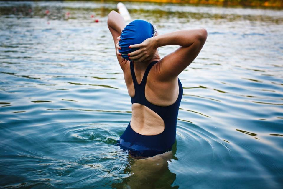Photo essay of Walden Pond swimmers in early morning.
