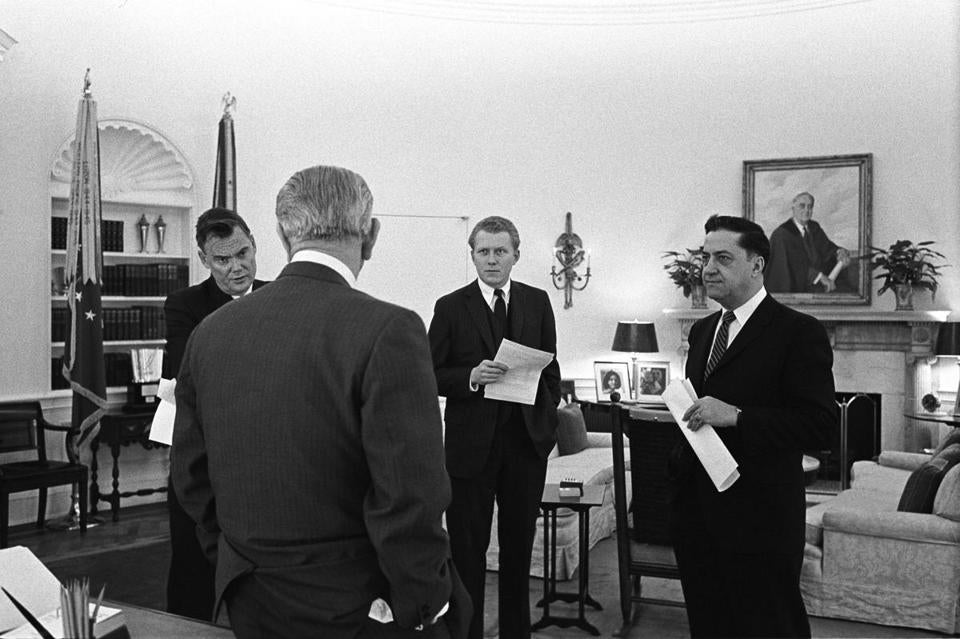 Robert Hardesty (center) was hired as a speechwriter for President Lyndon Johnson in 1965.