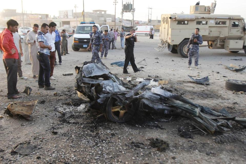 Iraqi security forces inspected the site of a car bomb attack in which 7 civilians were hurt in Kirkuk Thursday.