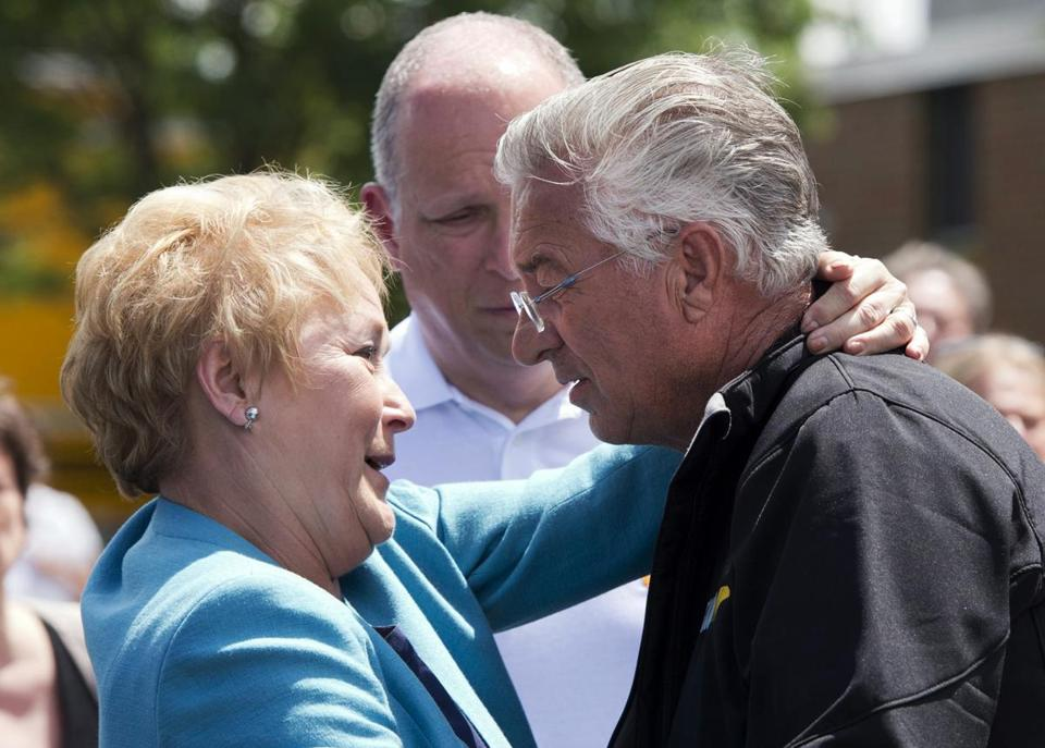 Quebec Premier Pauline Marois embraced Raymond Lafontaine, who lost his son and two daughters-in-law in the crash, during her visit to Lac-Megantic on Thursday.