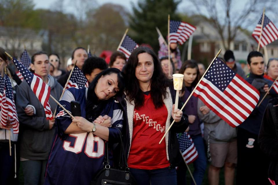 People gathered on a field during a vigil April 20 in Watertown for the victims of the Boston Marathon bombings.
