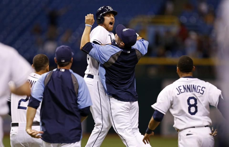 The Rays' Ben Zobrist celebrates with Sean Rodriguez after driving in the winning run against the Twins.