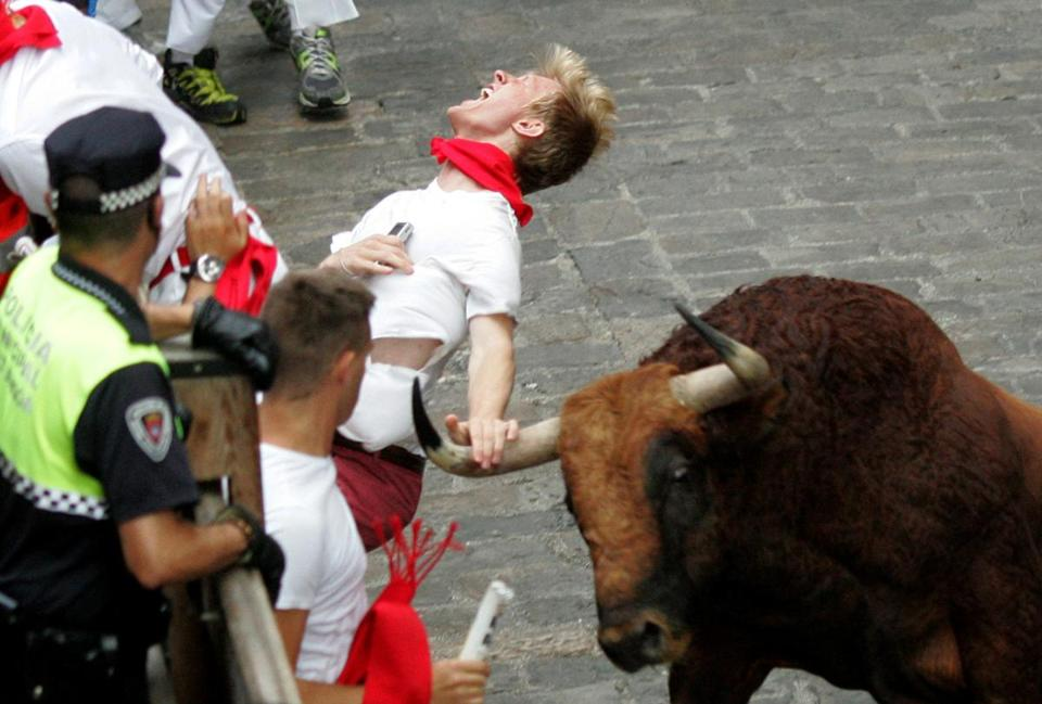 An unidentified runner was gored in Pamplona on Friday. The event was televised.
