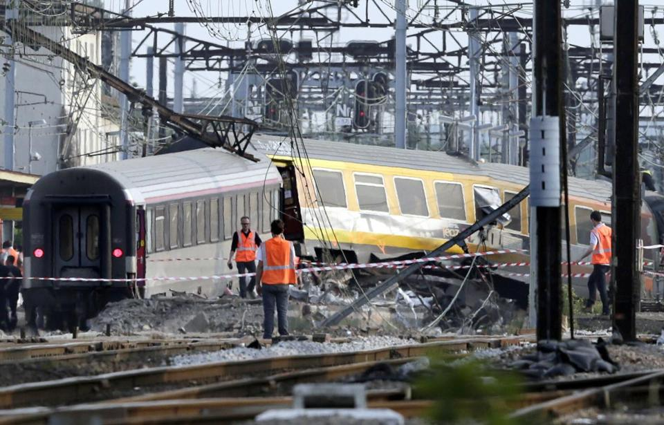 Rescue workers combed the site of a train accident near the Bretigny-sur-Orge railway station in a Paris suburb on Friday.