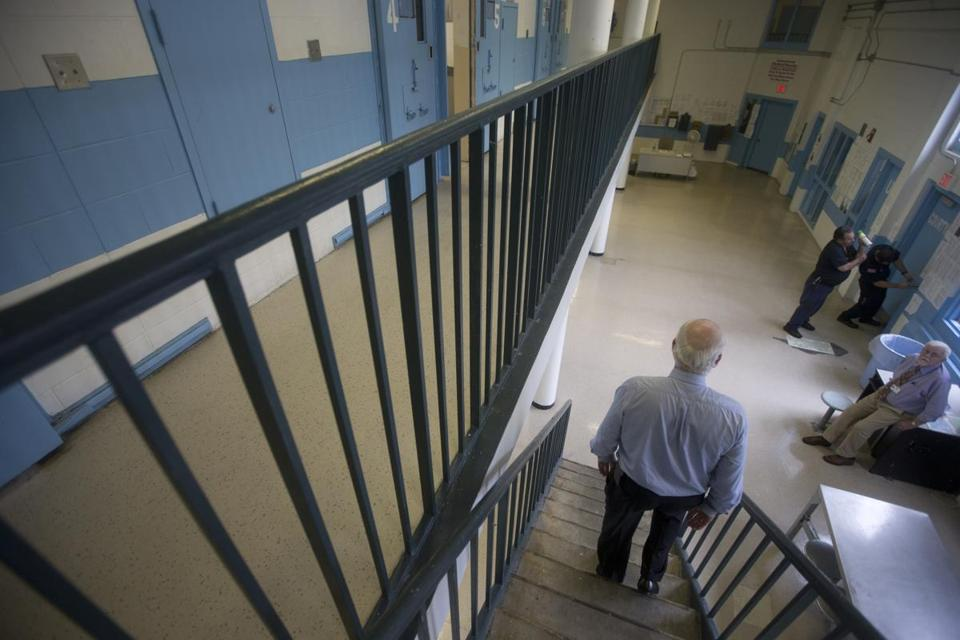 NORTH DARTMOUTH, MA-Bristol County Sheriff Tom Hodgson heads down from the top of a two-tiered cellblock at the Bristol County House of Corrections.