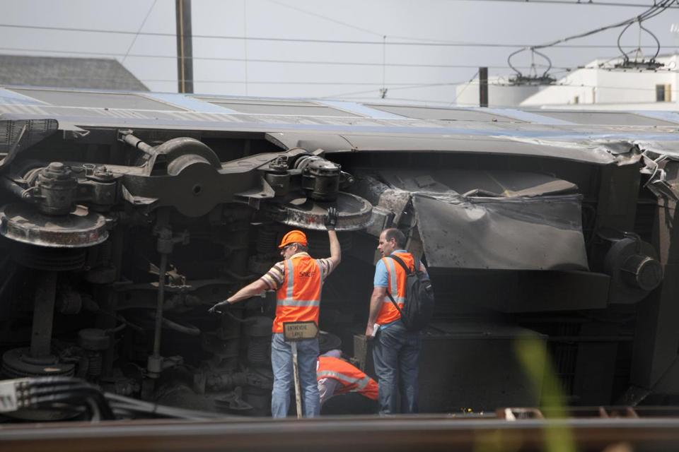 Workers inspected the wreckage of the train that crashed Friday while leaving Paris.