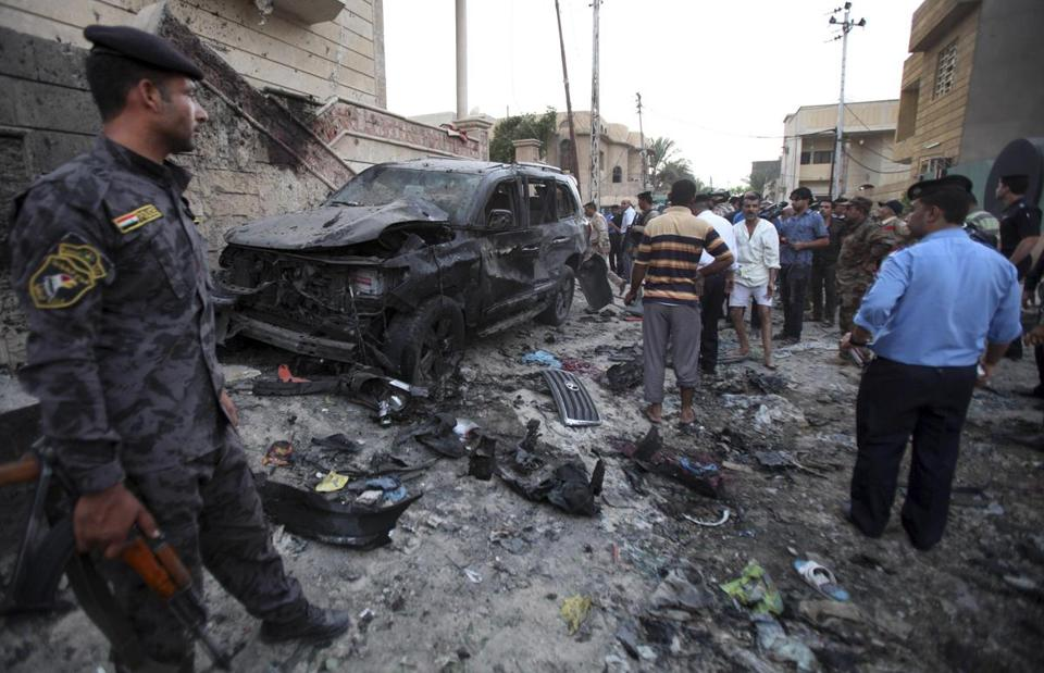 Twin explosions in Basra killed eight, the deadliest of a series of attacks mainly south of Baghdad on Sunday.