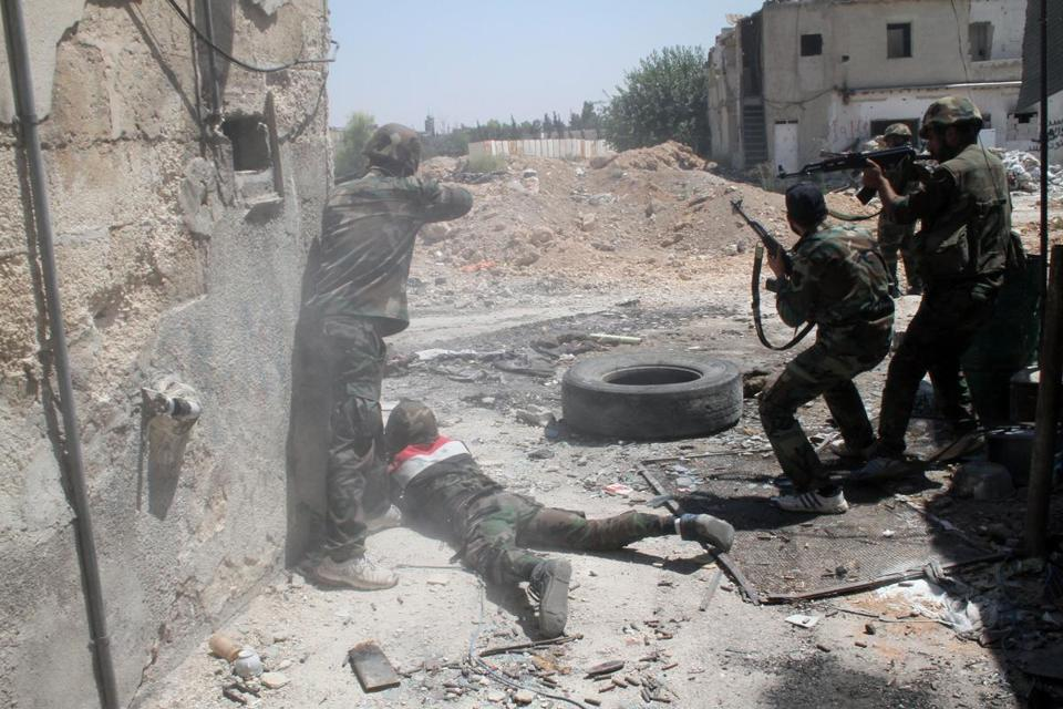 Syrian troops shot toward a rebel position on Sunday during a government media tour at the edge of Damascus.