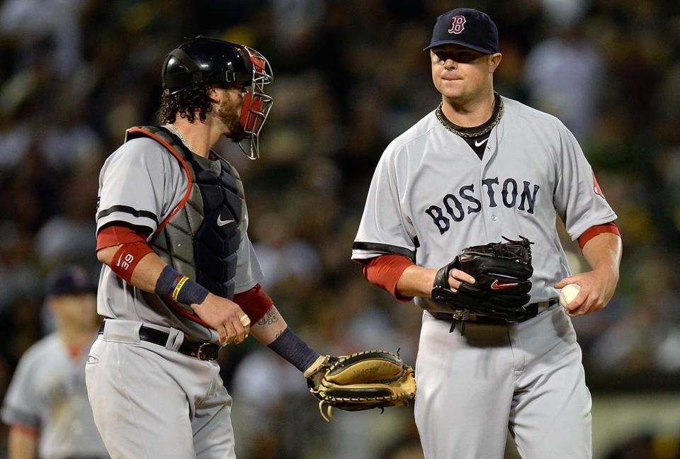Jon Lester left Saturday's game after putting two runners on in the seventh.