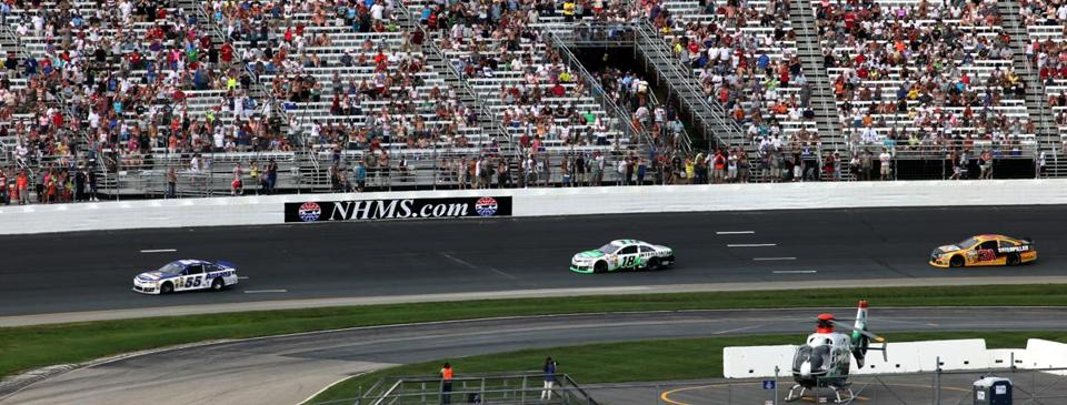 Brian Vickers (55) steams to the finish line well ahead of Kyle Busch (18) and Jeff Burton for his first win of the season.
