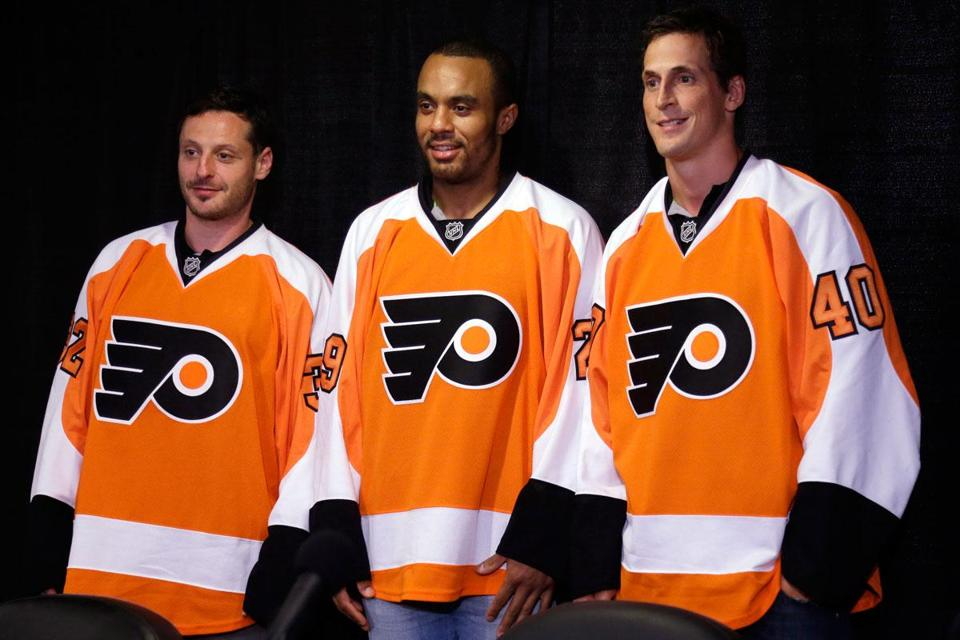 Philadelphia Flyers new acquisitions (from left) Mark Streit, Ray Emery, and Vincent Lecavalier.