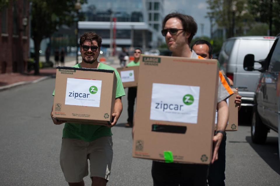 Traveling in a caravan of cars and vans, Zipcar employees moved from Cambridge on Monday to their new headquarters in Boston.