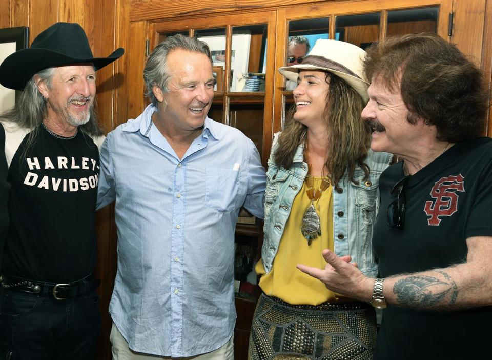 Doobie Brothers Patrick Simmons (left) and Tom Johnston (right) with Jay and Christy Cashman at Jay's birthday party in Chatham.