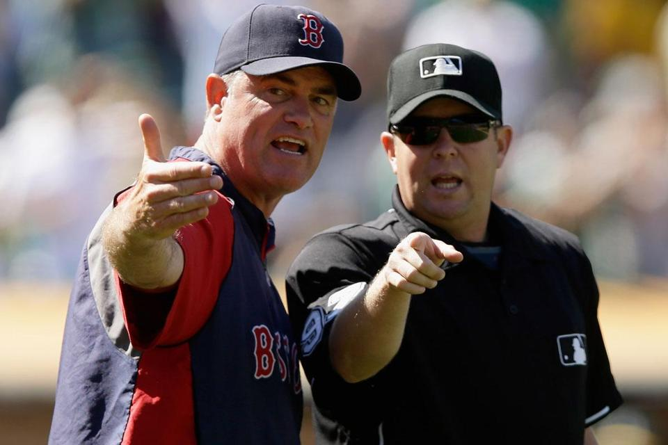 John Farrell argues with Todd Tichenor after the umpire awarded Yoenis Cespedes second base in the 10th.