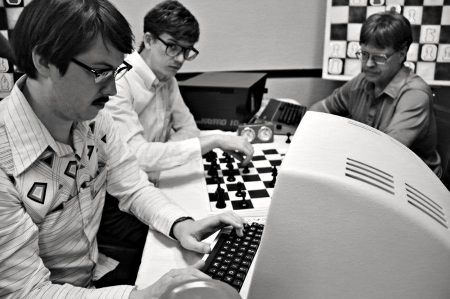 "Wiley Wiggins (left) and Patrick Riester (center) in ""Computer Chess,"" which was shot on circa 1980 video equipment."