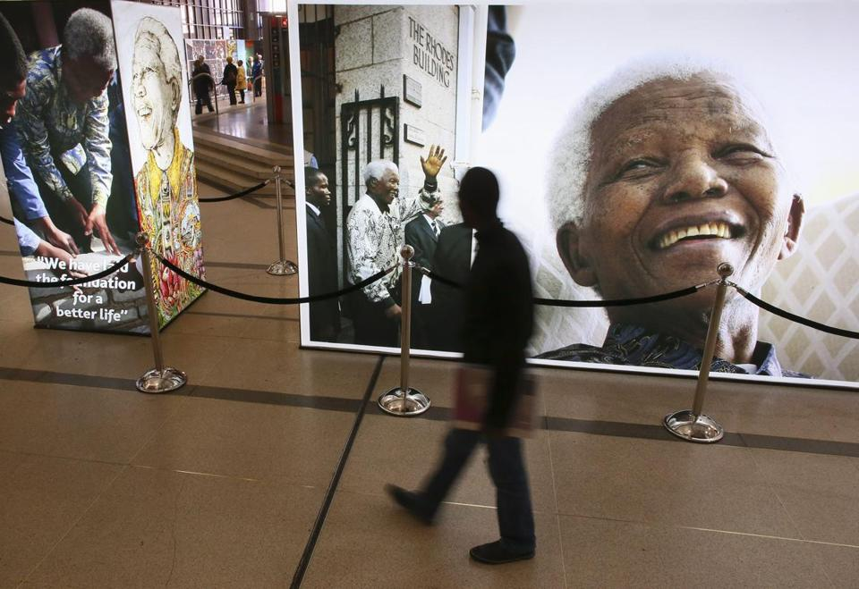 A man looked at images of former South African president Nelson Mandela presented by the City of Cape Town.