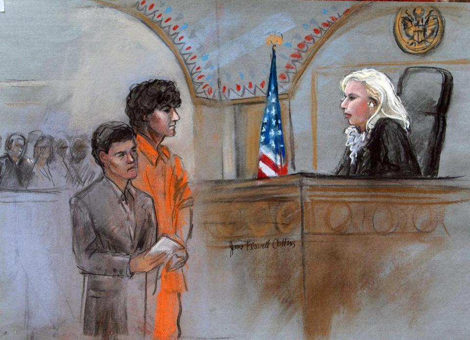 This courtroom sketch depicts Boston Marathon bombing suspect Dzhokhar Tsarnaev with his lawyer Miriam Conrad, left, before Magistrate Judge Marianne Bowler during his arraignment.