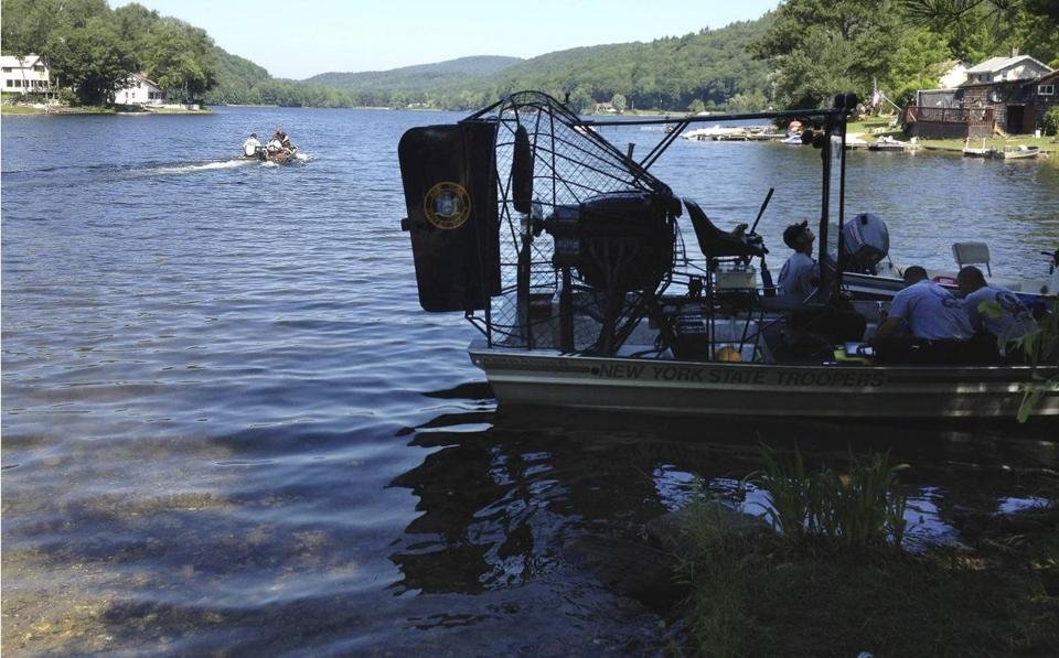 "Massachusetts and New York State Police dive teams headed out on Greenwater Pond to search for the body of James ""Jamie"" Lusher on Tuesday."