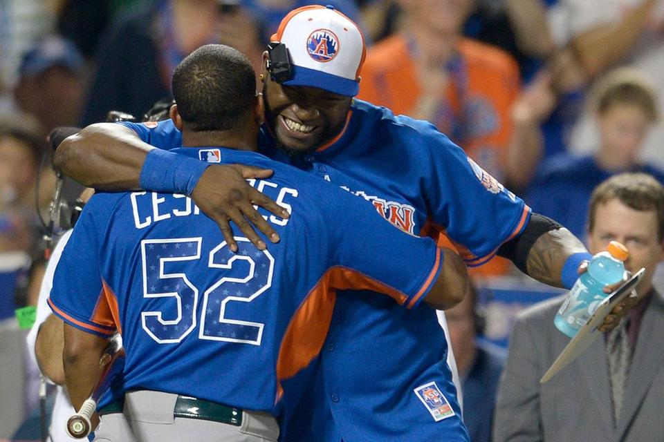 All-Star David Ortiz embraced Athletics slugger Yoenis Cespedes during the Home Run Derby. Cespedes went on to win the event.