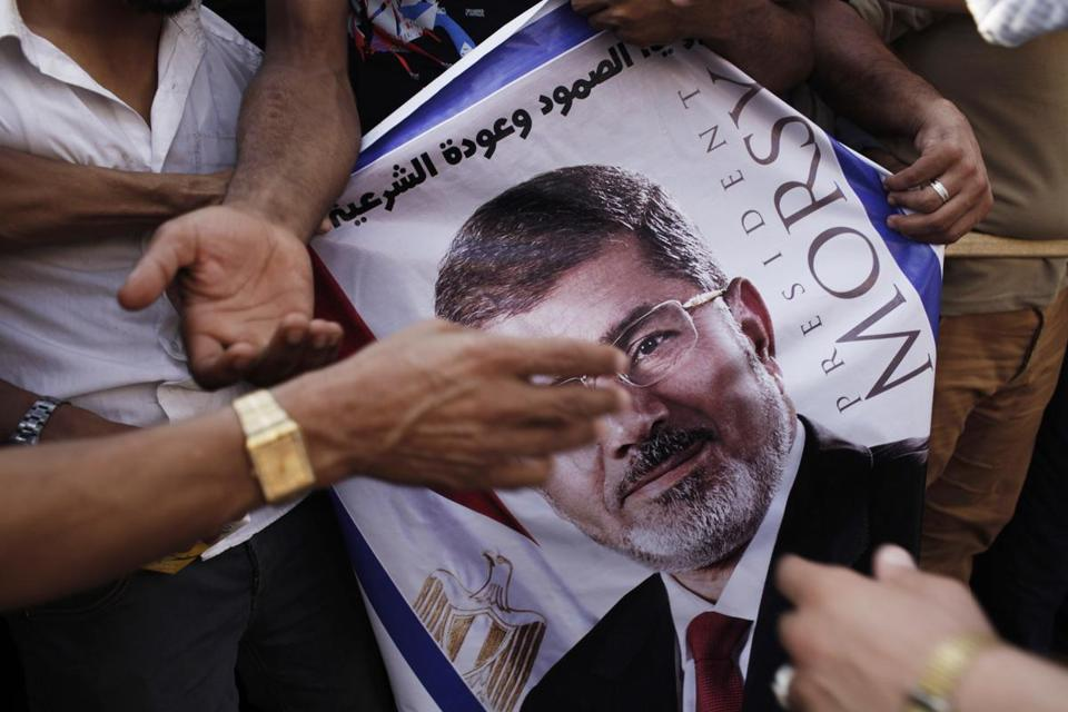 A poster of deposed Egyptian President Mohammed Morsi held by supporters in Cairo.
